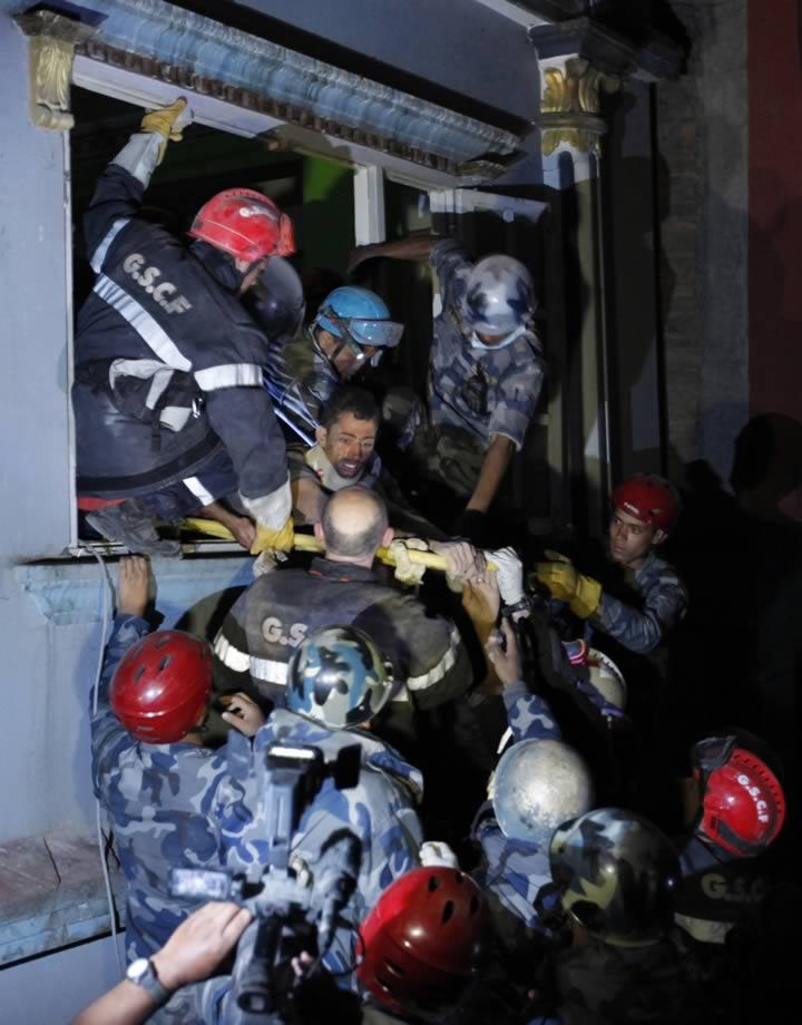 "<div class=""meta image-caption""><div class=""origin-logo origin-image none""><span>none</span></div><span class=""caption-text"">Survivor Rishi Khanal, 27, is freed by French rescuers from the ruins of a three-story hotel in the Gangabu area of Kathmandu, Nepal, Tuesday, April 28, 2015. (AP Photo/Niranjan Shrestha)</span></div>"