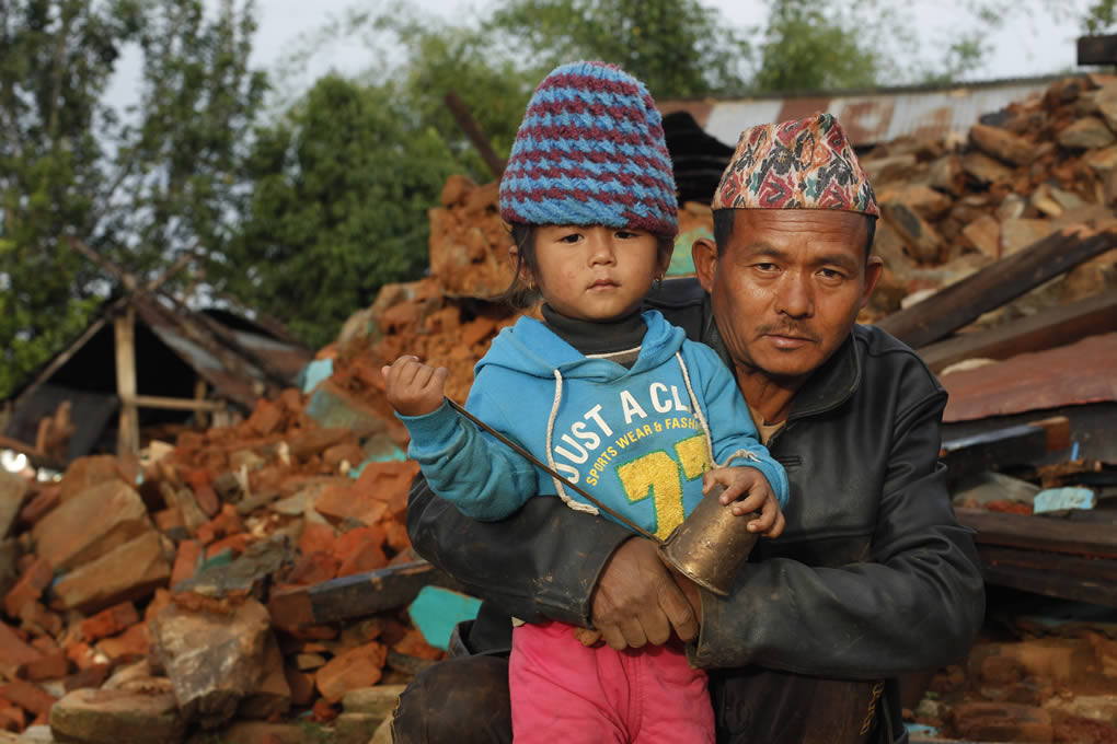 """<div class=""""meta image-caption""""><div class=""""origin-logo origin-image none""""><span>none</span></div><span class=""""caption-text"""">Lok Thapa holds a niece, Akin Thapa, in the rubble of his collapsed home near the epicenter of Saturday's massive quake in the Gorkha District of Nepal, April 28, 2015. (AP Photo/Wally Santana)</span></div>"""