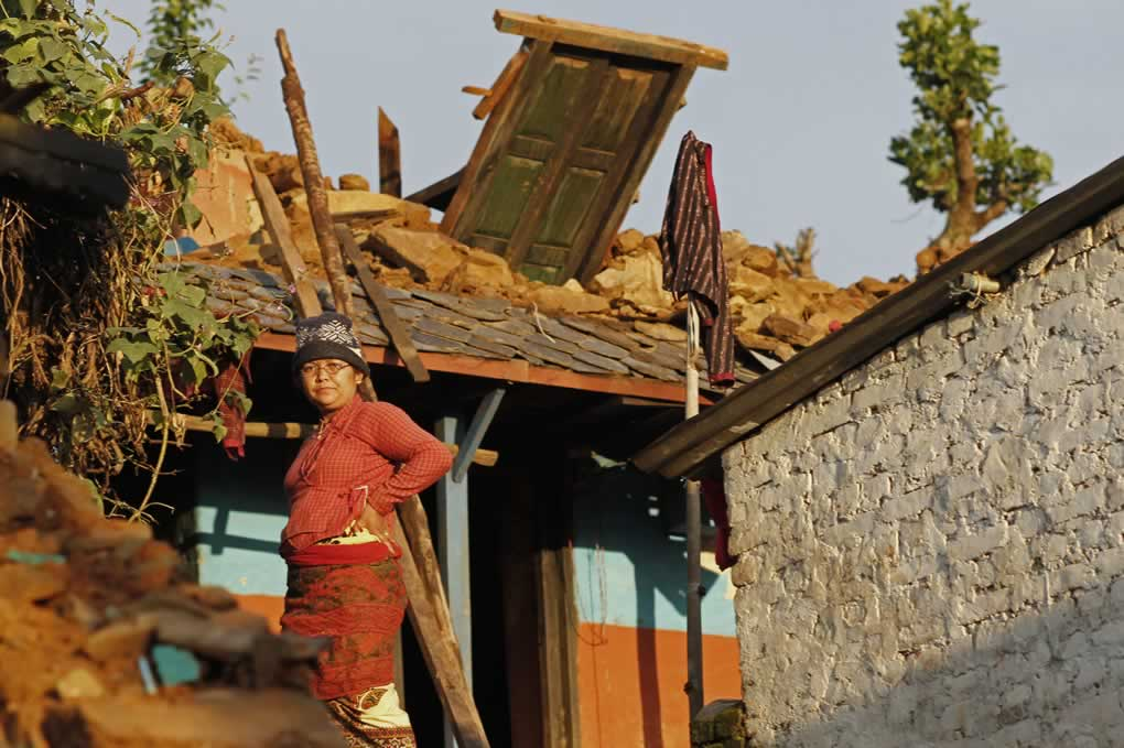 """<div class=""""meta image-caption""""><div class=""""origin-logo origin-image none""""><span>none</span></div><span class=""""caption-text"""">A villager surveys the damage of her home in Paslang village near the epicenter of Saturday's massive earthquake in the Gorkha District of Nepal, April 28, 2015. (AP Photo/Wally Santana)</span></div>"""