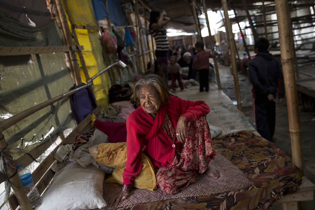 """<div class=""""meta image-caption""""><div class=""""origin-logo origin-image none""""><span>none</span></div><span class=""""caption-text"""">An elderly woman sits inside a residents makeshift area in Bhaktapur, Nepal, April 28, 2015. Many people have camped outdoors in the chilly night cold since the massive quake. (AP Photo/Bernat Armangue)</span></div>"""