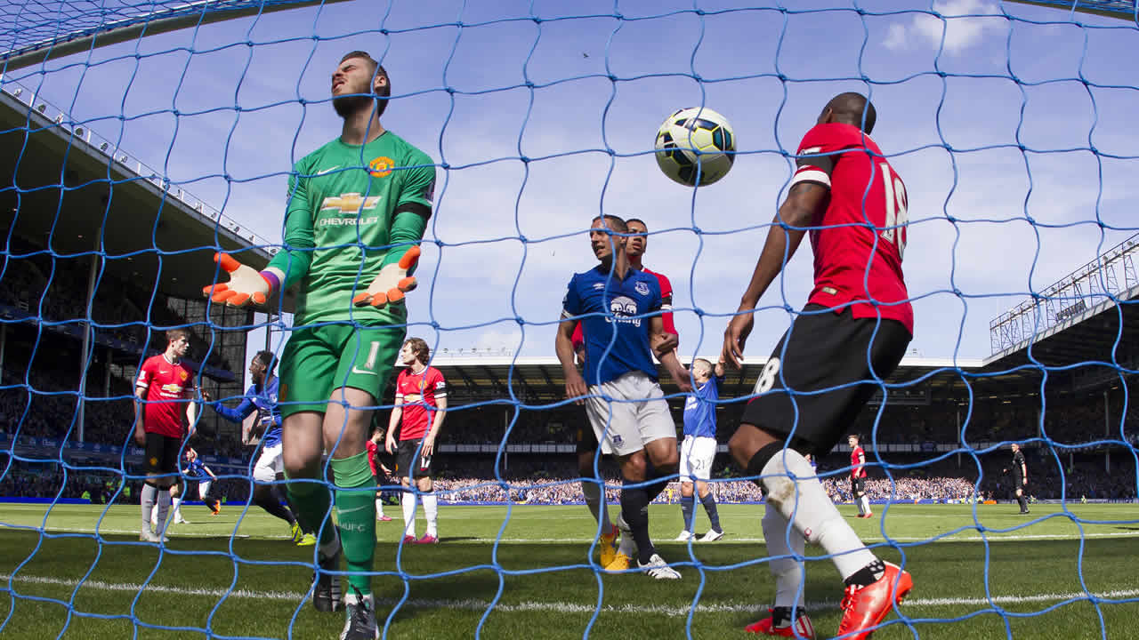 FILE - In this April 26, 2015 file photo Manchester United's goalkeeper David De Gea reacts in frustration after a goal at Goodison Park Stadium, Liverpool, England. (AP Photo)