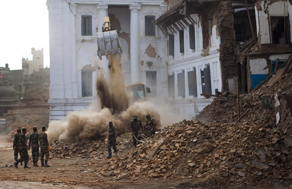 """<div class=""""meta image-caption""""><div class=""""origin-logo origin-image none""""><span>none</span></div><span class=""""caption-text"""">An earthmover clears rubble, with Nepalese army soldiers standing by at Kathmandu Durbar Square, a UNESCO World Heritage Site, in Kathmandu, Nepal, Wednesday, April 29, 2015. (AP Photo/Manish Swarup)</span></div>"""