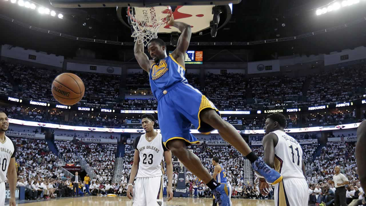Golden State Warriors forward Harrison Barnes (40) slam-dunks during Game 4 of a first-round NBA basketball playoff series in New Orleans, Saturday, April 25, 2015.