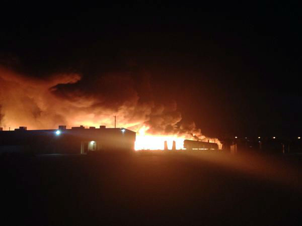 """<div class=""""meta image-caption""""><div class=""""origin-logo origin-image none""""><span>none</span></div><span class=""""caption-text"""">Fresno Firefighters battling a huge blaze at a utility pole yard. Stacks and stacks of poles sending smoke that can be seen for miles. (KFSN Photo/ #abc30insider Matt Hackney)</span></div>"""