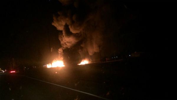 "<div class=""meta image-caption""><div class=""origin-logo origin-image none""><span>none</span></div><span class=""caption-text"">Large fire at utility yard burning pile of power poles (KFSN Photo/ #abc30insider)</span></div>"