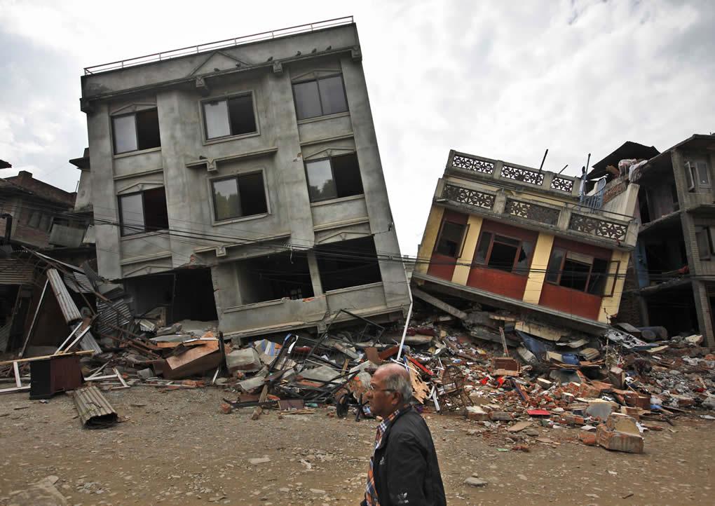 "<div class=""meta image-caption""><div class=""origin-logo origin-image none""><span>none</span></div><span class=""caption-text"">A Nepalese man walks past damaged buildings in Lalitpur, on the outskirts of Kathmandu, Nepal, Thursday, April 30, 2015. (AP Photo/Niranjan Shrestha)</span></div>"