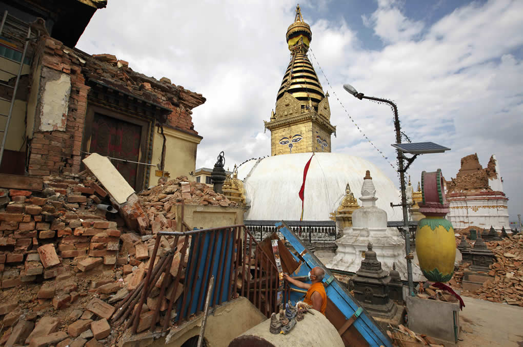"""<div class=""""meta image-caption""""><div class=""""origin-logo origin-image none""""><span>none</span></div><span class=""""caption-text"""">A Buddhist monk salvages religious items from a monastery around the famous Swayambhunath stupa after it was damaged by Saturday's earthquake in Kathmandu, Nepal, April 30, 2015. (AP Photo/Niranjan Shrestha)</span></div>"""