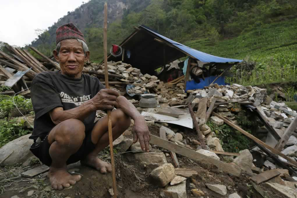 """<div class=""""meta image-caption""""><div class=""""origin-logo origin-image none""""><span>none</span></div><span class=""""caption-text"""">An elderly man sits at his collapsed home in the destroyed village of Jalingi, near the epicenter of Saturday's massive quake, in the Gorkha District of Nepal, April 30, 2015. (AP Photo/Wally Santana)</span></div>"""