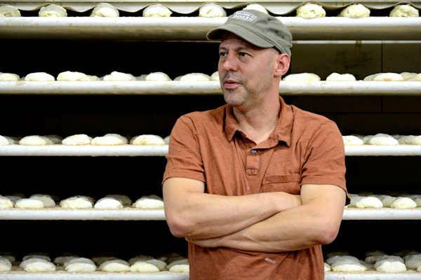 "<div class=""meta image-caption""><div class=""origin-logo origin-image none""><span>none</span></div><span class=""caption-text"">Jim Lahey in the Hell's Kitchen location of Sullivan Street Bakery</span></div>"