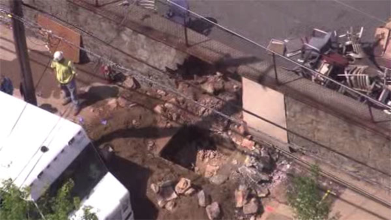Person briefly trapped after wall collapse in Brewerytown