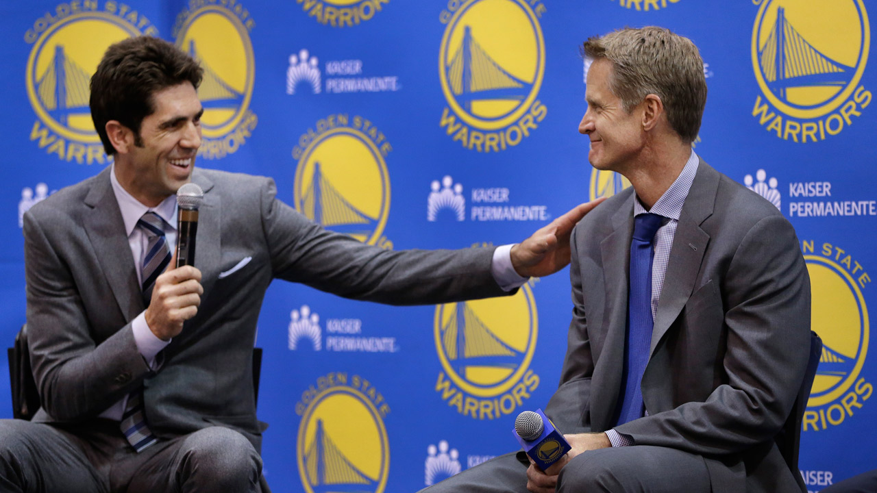 Golden State Warriors general manager Bob Myers, left, and coach Steve Kerr smile during a news conference Tuesday, May 20, 2014.