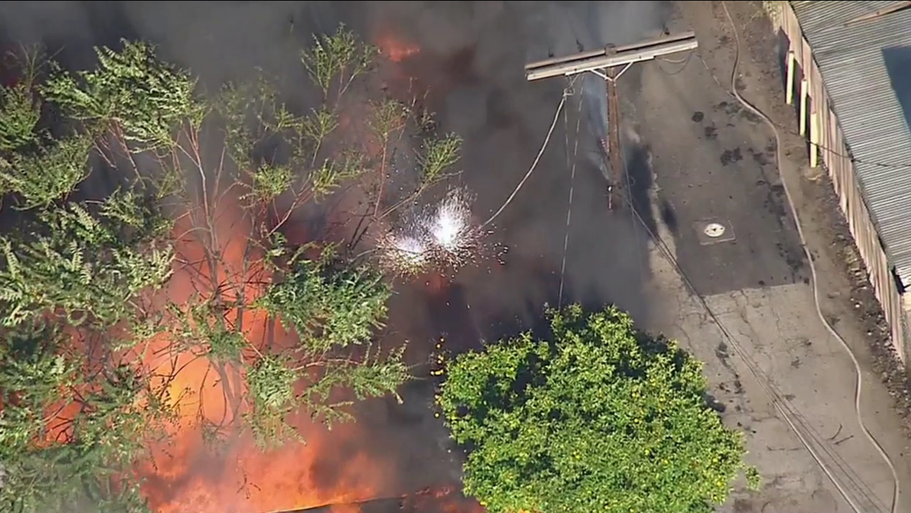 Sparks fly after a large fire breaks out at a shed of a Lincoln Heights home on Friday, May 1, 2015.