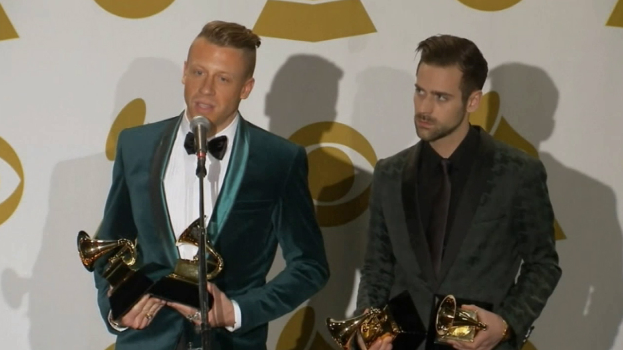 Macklemore, left, and Ryan Lewis speak in the press room about winning four GRAMMY Awards at Staples Center on Sunday, Jan. 26, 2014.