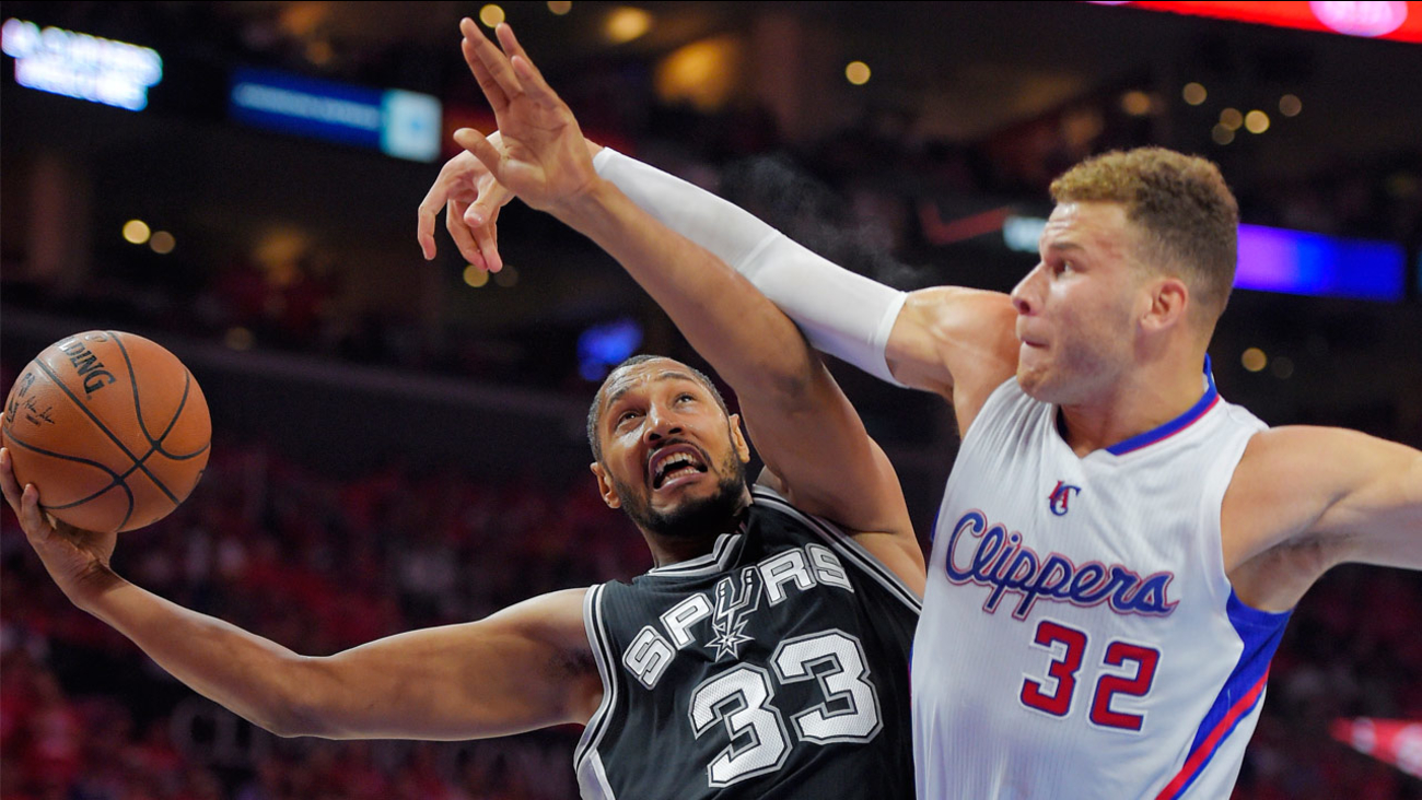 San Antonio Spurs center Boris Diaw, of France, shoots as Los Angeles Clippers forward Blake Griffin defends during Game 7 in the NBA basketball playoffs on Saturday, May 2, 2015.