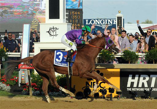 "<div class=""meta image-caption""><div class=""origin-logo origin-image ""><span></span></div><span class=""caption-text"">California Chrome, ridden by jockey Victor Espinoza, wins the second leg of the Triple Crown as he runs away with the 139th Preakness Stakes.</span></div>"