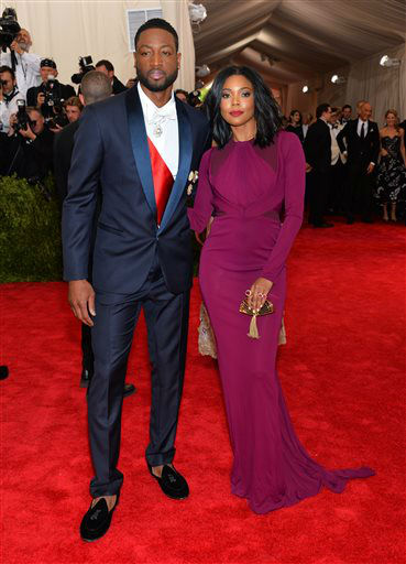 "<div class=""meta image-caption""><div class=""origin-logo origin-image none""><span>none</span></div><span class=""caption-text"">Dwyane Wade, left, and Gabrielle Union arrive at The Metropolitan Museum of Art's Costume Institute benefit gala. (Photo by Evan Agostini/Invision/AP) (AP Photo/ Evan Agostini)</span></div>"