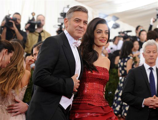 "<div class=""meta image-caption""><div class=""origin-logo origin-image none""><span>none</span></div><span class=""caption-text"">George Clooney and Amal Clooney arrive at The Metropolitan Museum of Art's Costume Institute benefit gala. (Photo by Evan Agostini/Invision/AP) (AP Photo/ Evan Agostini)</span></div>"