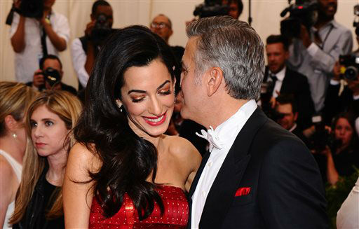 "<div class=""meta image-caption""><div class=""origin-logo origin-image none""><span>none</span></div><span class=""caption-text"">Amal Clooney, left, and George Clooney arrive at The Metropolitan Museum of Art's Costume Institute benefit gala. (Photo by Charles Sykes/Invision/AP) (AP Photo/ Charles Sykes)</span></div>"
