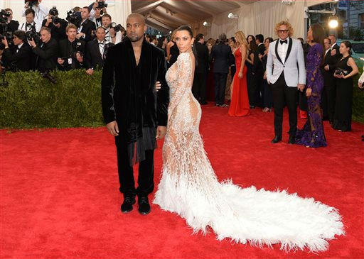 "<div class=""meta image-caption""><div class=""origin-logo origin-image none""><span>none</span></div><span class=""caption-text"">Kanye West and Kim Kardashian arrives at The Metropolitan Museum of Art's Costume Institute benefit gala. (Photo by Evan Agostini/Invision/AP) (AP Photo)</span></div>"
