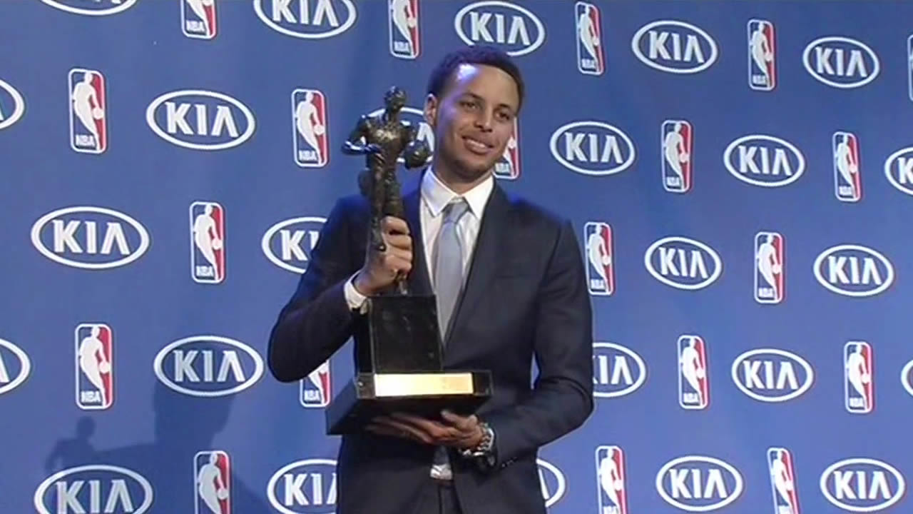 Golden State Warriors star Steph Curry smiles as he holds the NBA's Most Valuable Player award in Oakland, Calif. on May 4, 2015.