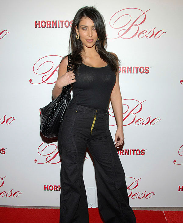 """<div class=""""meta image-caption""""><div class=""""origin-logo origin-image none""""><span>none</span></div><span class=""""caption-text"""">Kim Kardashian at the grand opening celebration of Beso, a restaurant owned by actress Eva Longoria in Los Angeles on Thursday, March 6, 2008. (AP)</span></div>"""