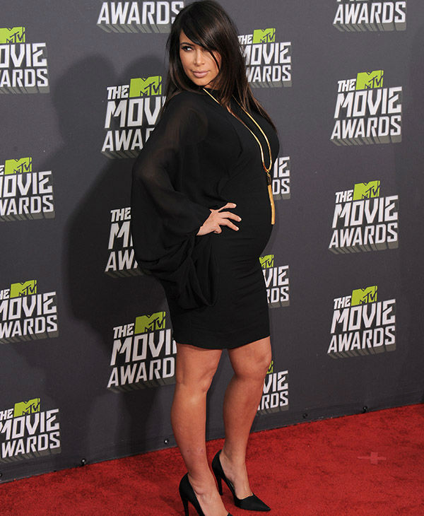 """<div class=""""meta image-caption""""><div class=""""origin-logo origin-image none""""><span>none</span></div><span class=""""caption-text"""">Kim Kardashian arrives at the MTV Movie Awards in Sony Pictures Studio Lot in Culver City, Calif., on Sunday April 14, 2013. (AP)</span></div>"""