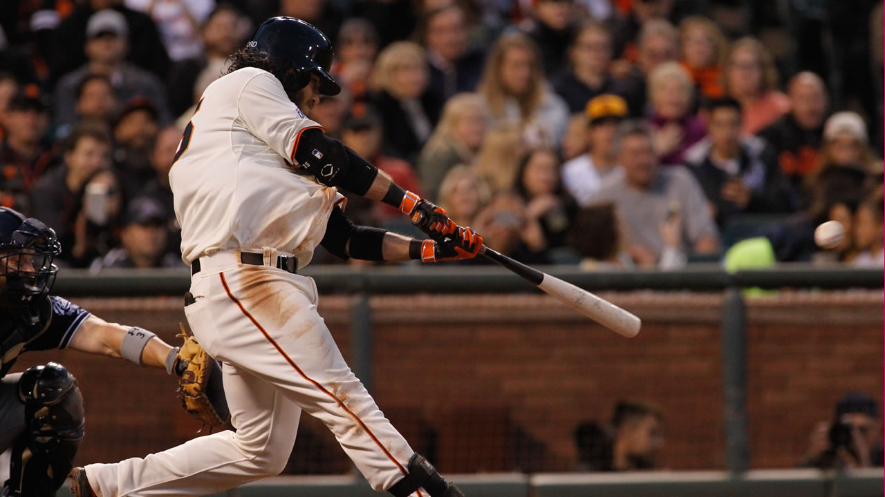 San Francisco Giants' Brandon Crawford hits an RBI double in the third inning of a baseball game against the San Diego Padres, Tuesday, May 5, 2015, in San Francisco.