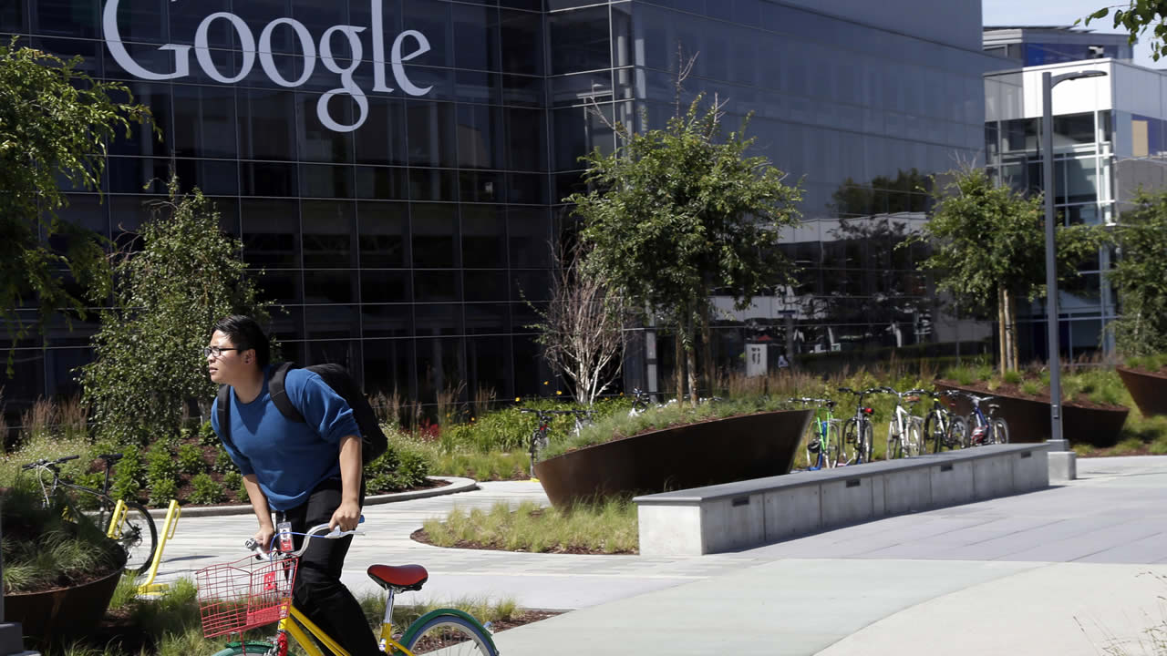 FILE: In this June 5, 2014 file photo, a worker rides a bike on Google's campus in Mountain View, Calif. (AP Photo/Marcio Jose Sanchez)
