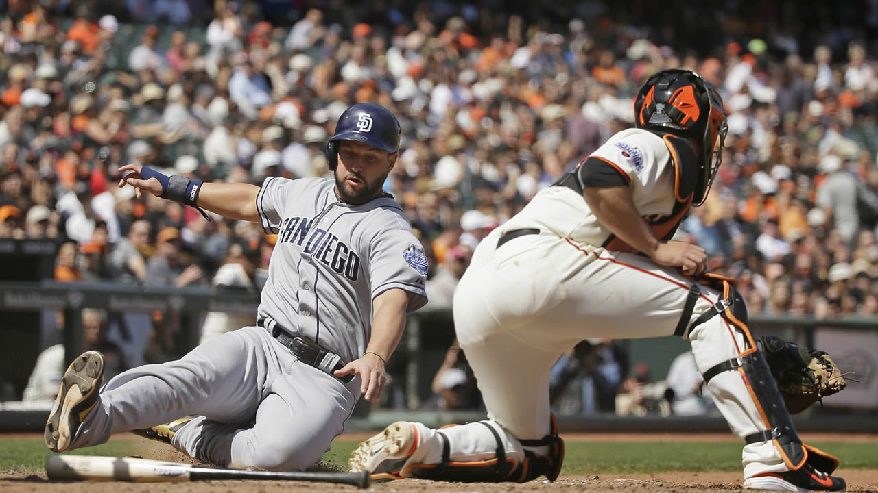 San Diego Padres' Yonder Alonso scores as San Francisco Giants catcher Andrew Susac waits for the throw in the eighth inning on Wednesday, May 6, 2015, in San Francisco.