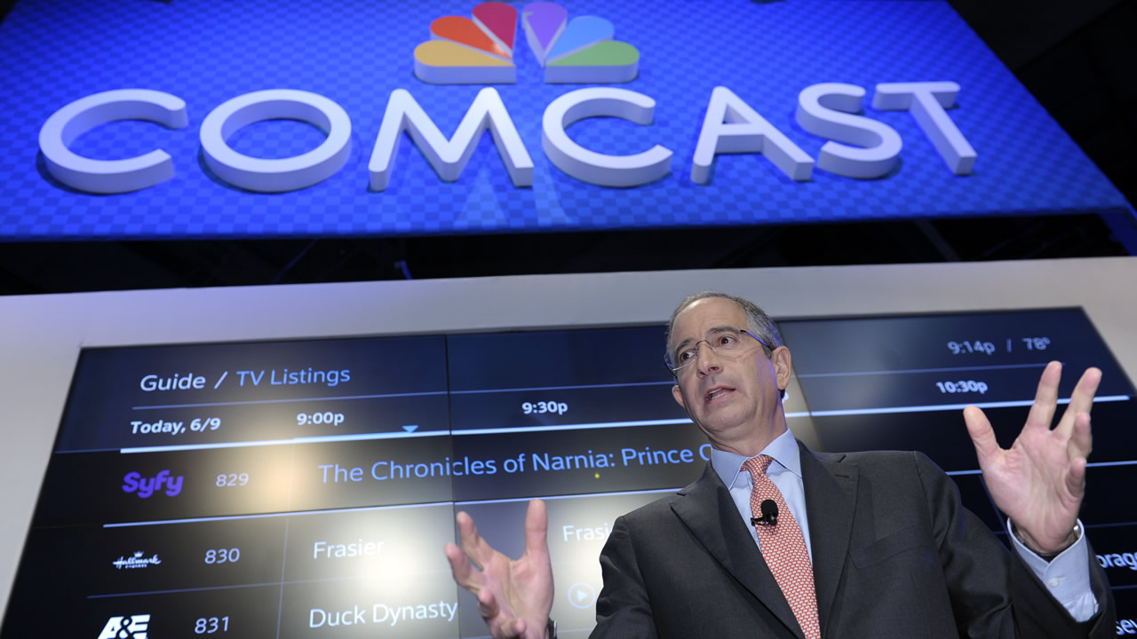 Comcast Corp. CEO Brian Roberts gestures as he speaks during The Cable Show 2013 convention in Washington