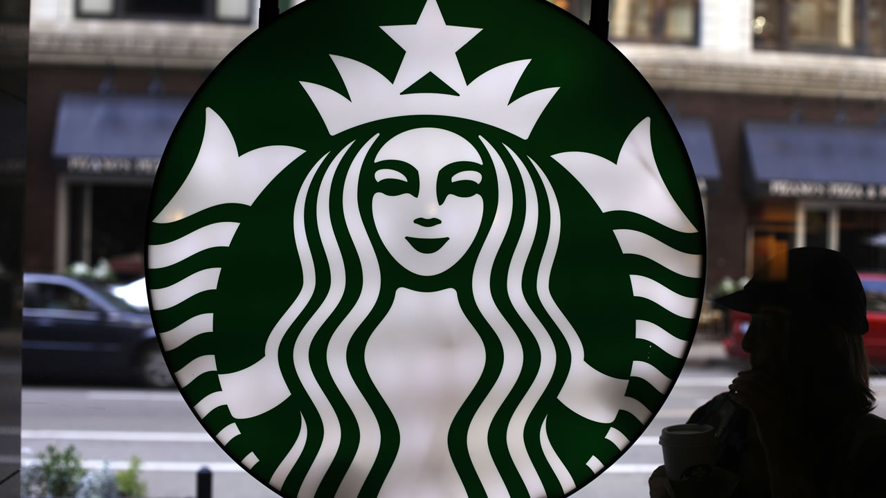 In this Saturday, May 31, 2014, file photo, the Starbucks logo is seen at one of the company's coffee shops in downtown Chicago.