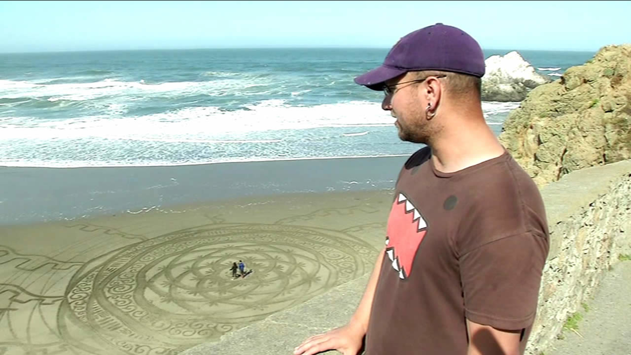 Brandon Anderton talks about an art display he created in the sand at San Francisco's Ocean Beach on May 7, 2015.
