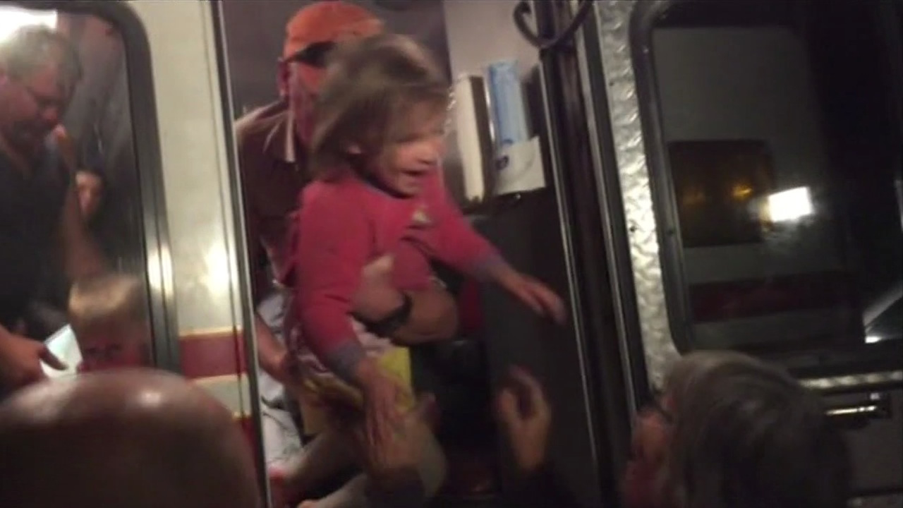 "<div class=""meta image-caption""><div class=""origin-logo origin-image none""><span>none</span></div><span class=""caption-text"">Nick Vlahos' daughter being reunited with her family after being rescued from the Sierra on Thursday, May 7, 2015. (KGO)</span></div>"