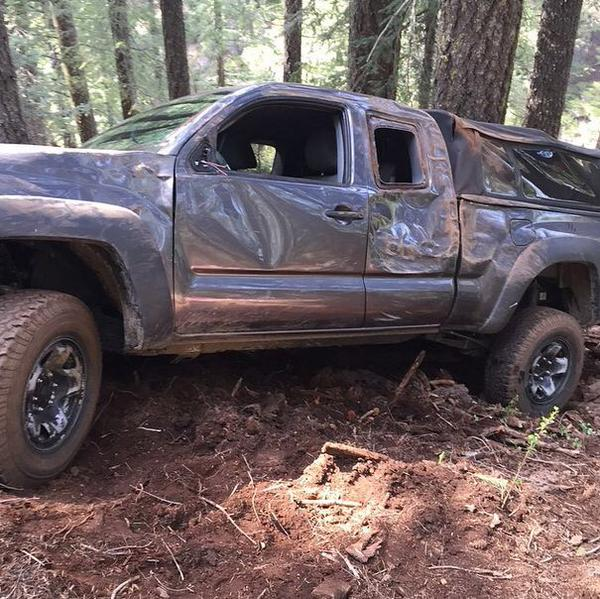 "<div class=""meta image-caption""><div class=""origin-logo origin-image none""><span>none</span></div><span class=""caption-text"">Nick Vlahos' photo of his Toyota Tundra. It slid sideways down an embankment after ground gave way & hit tree. (Photo submitted by Nick Vlahos).</span></div>"