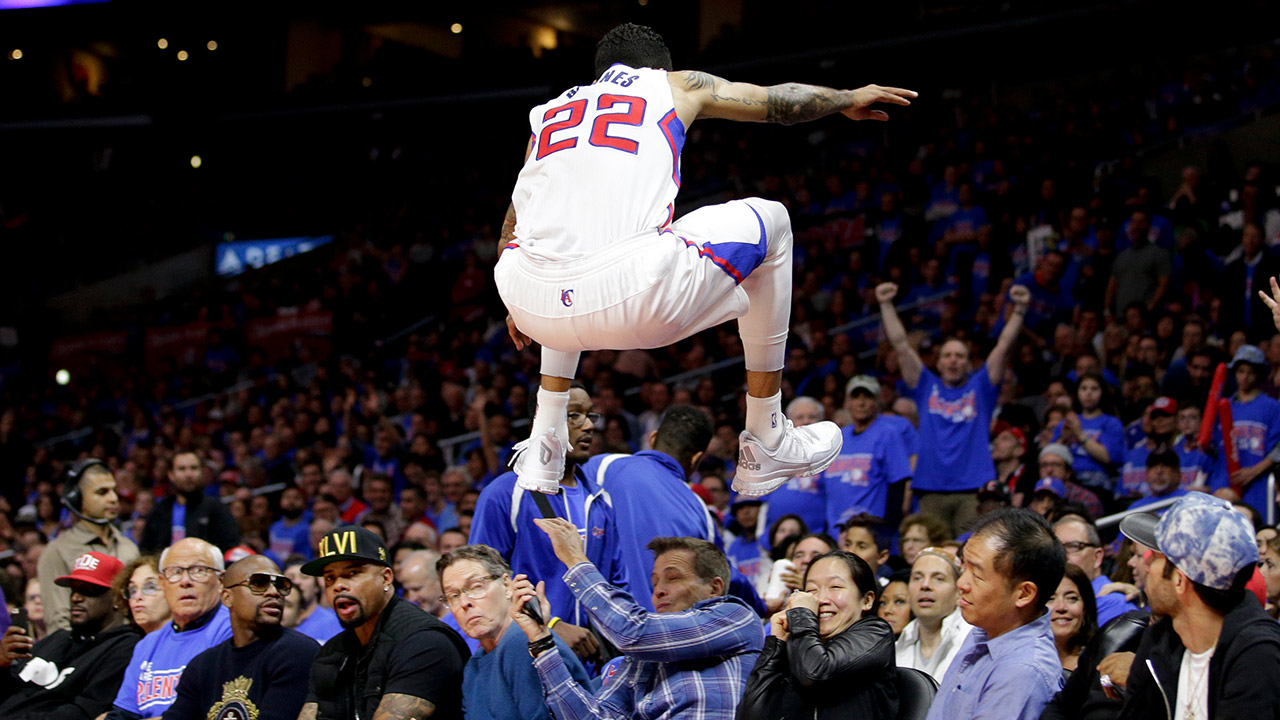 Los Angeles Clippers forward Matt Barnes soars over a row of fans while going after a loose ball during the second half of Game 3 in a second-round NBA basketball playoff series against the Houston Rockets, Friday, May 8, 2015, in Los Angeles.