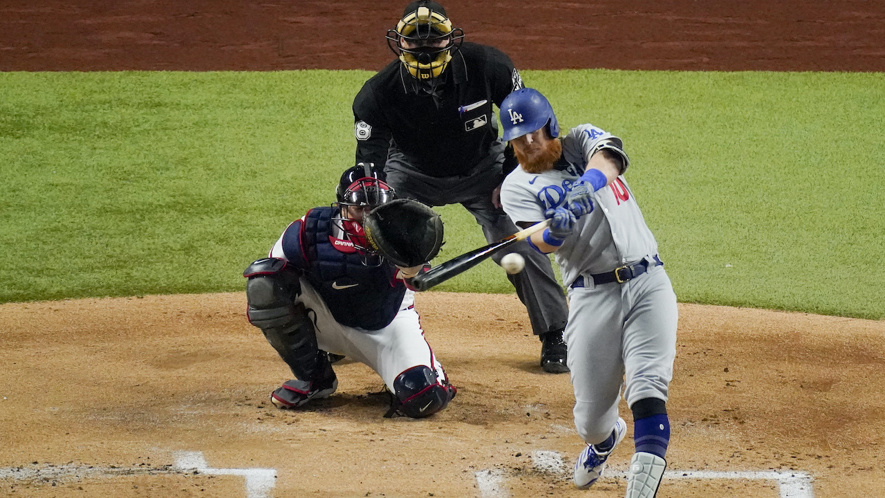 Los Angeles Dodgers' Justin Turner hits a double against the Atlanta Braves during Game 5 of the National League Championship Series Friday, Oct. 16, 2020, in Arlington, Texas.