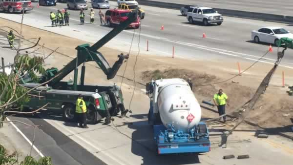 An overturned tanker truck backed up traffic on I-280 in San Jose, Calif. on Saturday, May 9, 2015.