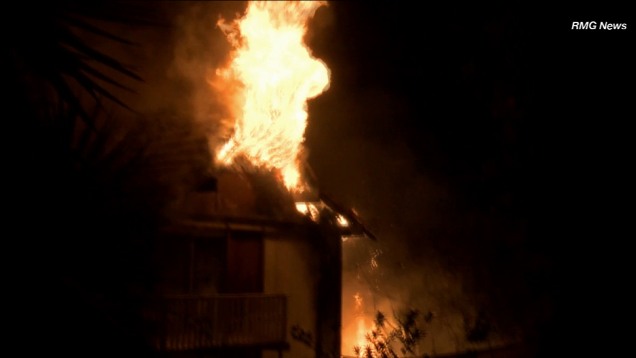 Flames shoot through the roof of a two-story house in the 700 block of Grand Avenue in Glendora Sunday, May 10, 2015.