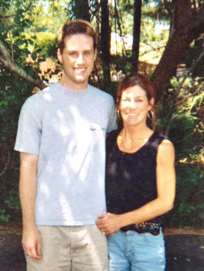 "<div class=""meta image-caption""><div class=""origin-logo origin-image none""><span>none</span></div><span class=""caption-text"">Jeff Smith and his Mom.</span></div>"
