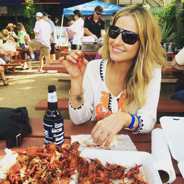 """<div class=""""meta image-caption""""><div class=""""origin-logo origin-image none""""><span>none</span></div><span class=""""caption-text"""">Katherine Whaley digging in on crawfish (KTRK Photo)</span></div>"""