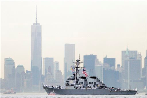 """<div class=""""meta image-caption""""><div class=""""origin-logo origin-image """"><span></span></div><span class=""""caption-text"""">Sailors line the bow of the destroyer USS McFaul as it glides past One World Trade Center and the lower Manhattan skyline, Wednesday, May 21, 2014 in New York harbor. (AP/Mark Lennihan)</span></div>"""