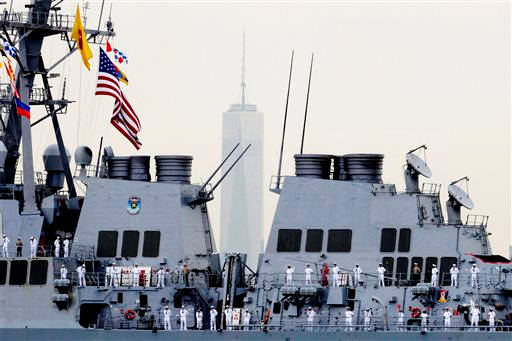 """<div class=""""meta image-caption""""><div class=""""origin-logo origin-image """"><span></span></div><span class=""""caption-text"""">Sailors line the decks of the destroyer USS Cole as it glides past One World Trade Center, Wednesday, May 21, 2014 in New York. (AP Photo/Mark Lennihan)</span></div>"""