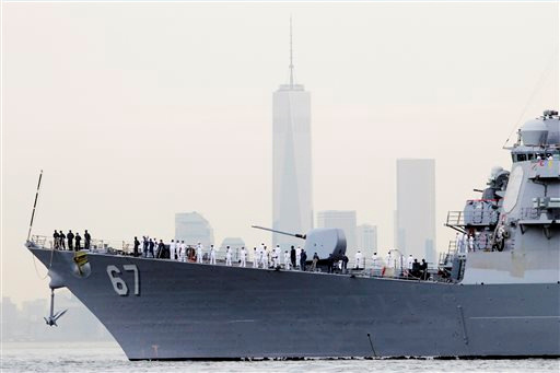 """<div class=""""meta image-caption""""><div class=""""origin-logo origin-image """"><span></span></div><span class=""""caption-text"""">Sailors line the bow of the destroyer USS Cole as it glides past One World Trade Center and the lower Manhattan skyline, Wednesday, May 21, 2014 in New York. (AP Photo/Mark Lennihan)</span></div>"""