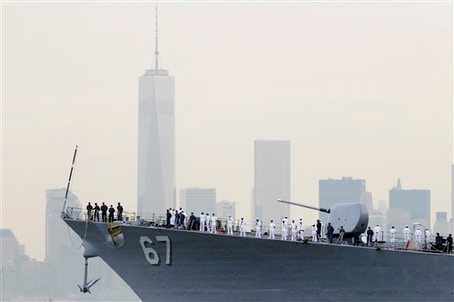 """<div class=""""meta image-caption""""><div class=""""origin-logo origin-image """"><span></span></div><span class=""""caption-text"""">Close-up of sailors lining the bow of the destroyer USS Cole as it glides past One World Trade Center and the lower Manhattan skyline, Wednesday, May 21, 2014 in New York. (AP Photo/Mark Lennihan)</span></div>"""