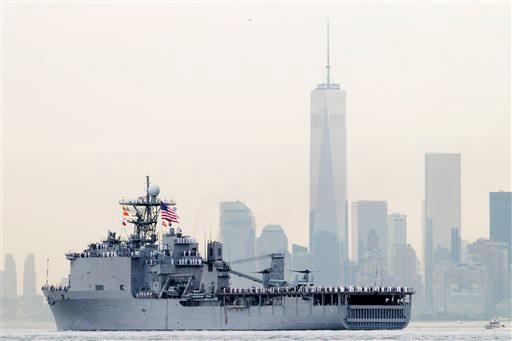 "<div class=""meta image-caption""><div class=""origin-logo origin-image ""><span></span></div><span class=""caption-text"">Sailors line the decks of the dock landing ship USS Oak Hill as it glides past One World Trade Center and the lower Manhattan skyline, Wednesday, May 21, 2014 in New York. (AP Photo/Mark Lennihan)</span></div>"