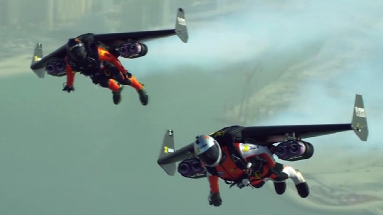 """Jetman"" Yves Rossy and Vince Reffet use jetpacks to fly high above Dubai."