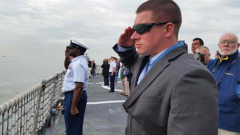 """<div class=""""meta image-caption""""><div class=""""origin-logo origin-image """"><span></span></div><span class=""""caption-text"""">Medal of Honor recipient Kyle White on U.S. Coast Guard cutter Campbell renders a salute to Ft. Hamilton. (U.S. Army)</span></div>"""
