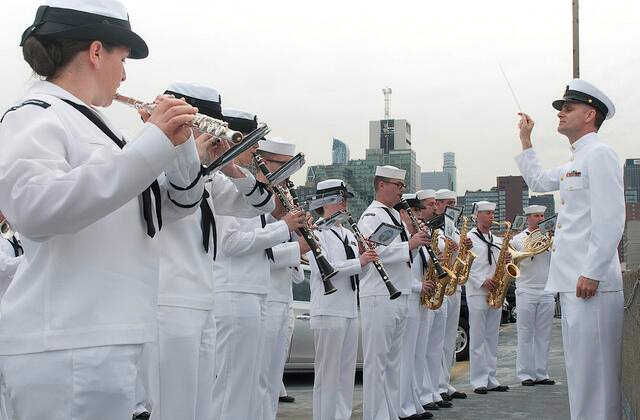 """<div class=""""meta image-caption""""><div class=""""origin-logo origin-image """"><span></span></div><span class=""""caption-text"""">Navy Band Northeast perform for guests on Pier 92 during the parade of ships.</span></div>"""