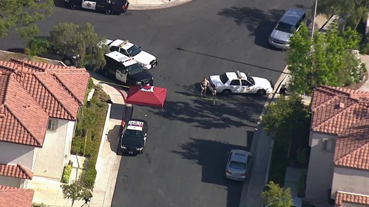 Orange County sheriff's deputies investigate a fatal deputy-involved shooting near Paseo Viento and Melinda Road in Rancho Santa Margarita Tuesday, May 12, 2015.