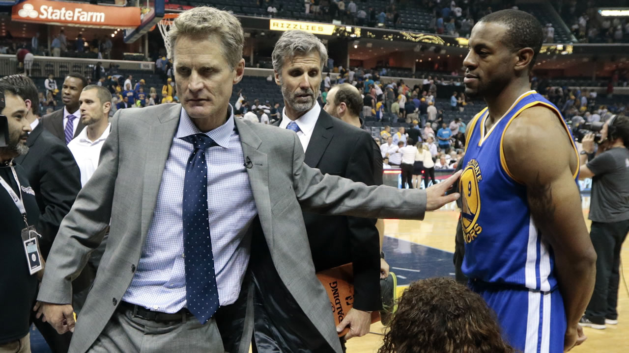 Golden State Warriors head coach Steve Kerr, left, congratulates Andre Iguodala (9) after they beat the Memphis Grizzlies in Game 4 of NBA basketball Western Conference playoffs.